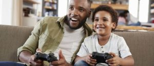 Family enjoy console gaming together