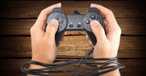 Man holds tangled video game controller