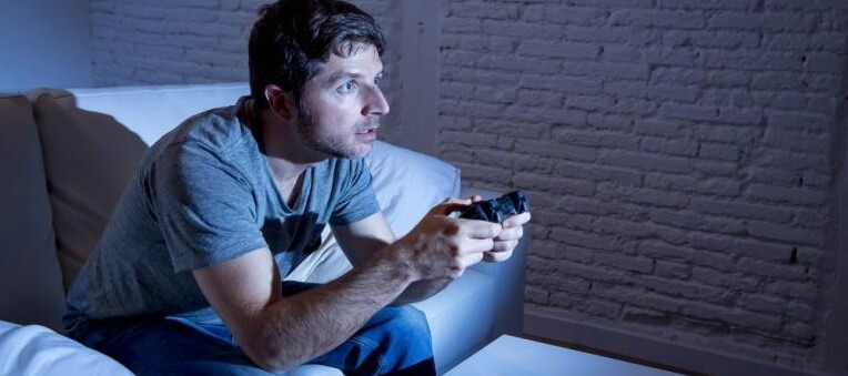 Young man hooked on gaming session